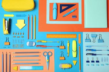 Flat lay composition with different school stationery on color background Wall mural