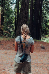 Hicking woman in a redwood forest