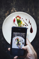 Chef taking picture of a dish