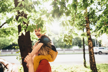 Smiling kid under the tree