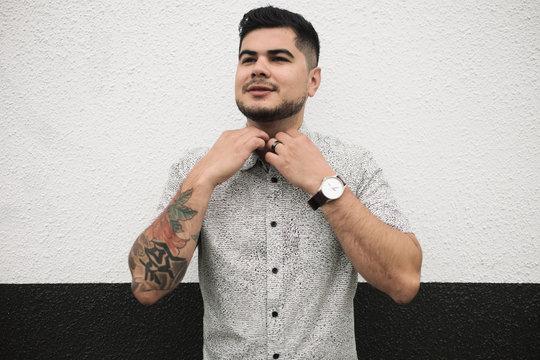 Portrait of Happy young hispanic - latino man in city