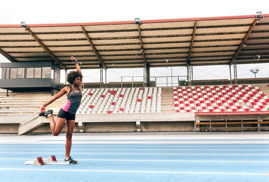 Black athlete woman in an athletics stadium