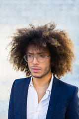 Portrait of a Young Businessman with Afro Hair Wearing a Classy