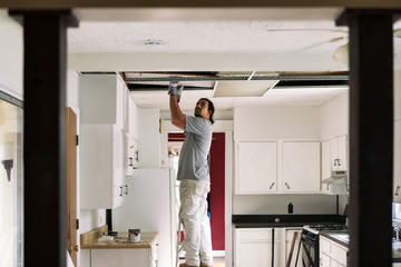Kitchen: Man Removing Drop Ceiling Tiles