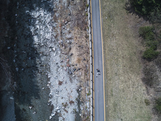 Man relaxing in a country road - aerial view