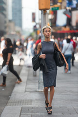 Young professional woman walking in the city