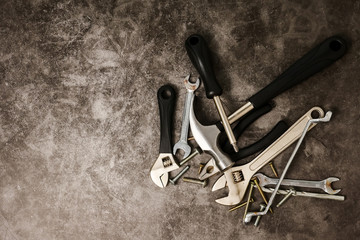 Construction tools on concrete texture background. Free space for text