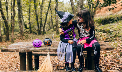 Two little girls disguised in Halloween