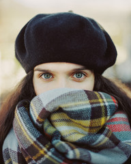 Woman in beret feeling cold
