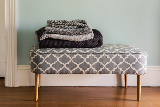 winter rugs on a bench seat at home