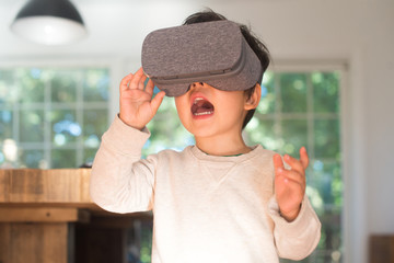 Little kid playing with virtual reality glasses