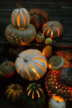 Carved pumpkins glowing in night