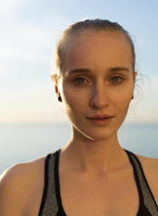 Young fit woman at seaside