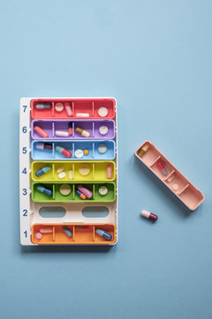 Colorful Case With Pills And Tablets On The Blue Background