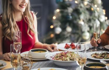 People Enjoying Christmas Lunch