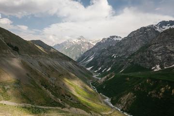 creek flowing through alpine tajik valley