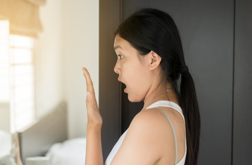 Asian woman covering her mouth and smell her breath with hands upter wake up,Bad smell,Selective focus