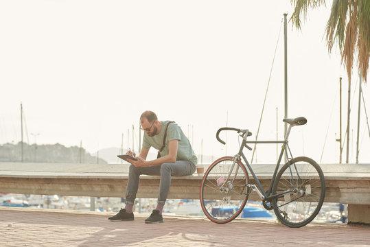 Businessman working on digital tablet during lunch break.