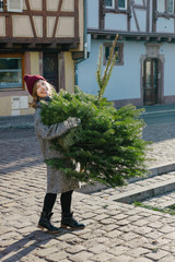 Smiling woman with fir bunch