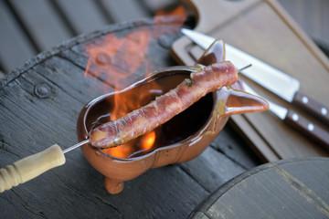 Brazilian food: sausage roasted in pinga