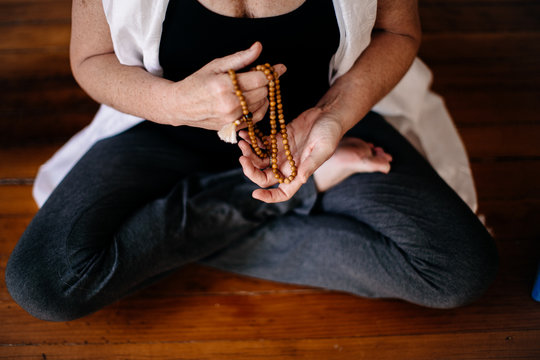Woman sitting with prayer beads