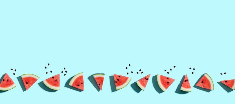 Sliced watermelons arranged on a blue background