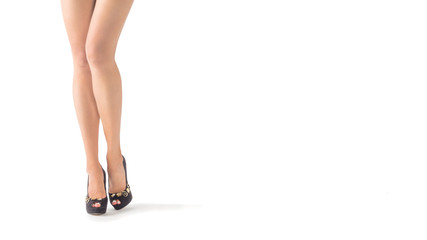 Woman legs wearing high heels isolated on white background
