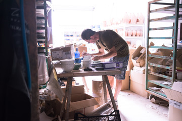 Ceramic dishes in working process. Creating ceramic pieces. Tradicional ceramic factory in spain