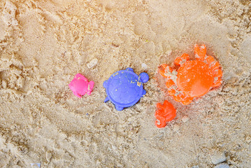 Yellow sand pail and blue shovel.Children's beach toys on the sand.Toys for children sandboxes on the beach, activity for kid.