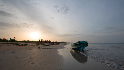 Small fishing boat / panga at sunset on Nilaveli beach in Trincomalee Sri Lanka Asia