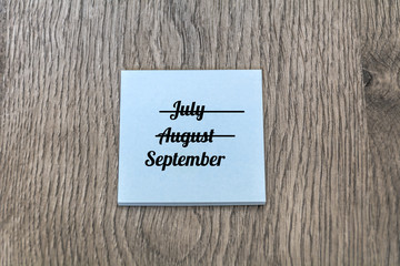 Three Summer Months - June, July and August Written on a Sticky Note .September Beginning and Summer end Concept
