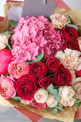 beautiful spring bouquet. flower arrangement with hydrangea and peonies. Color red and pink. The concept of a flower shop, a small family business