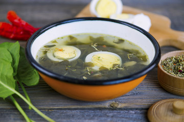 green sorrel soup with egg and spices