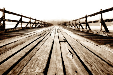 Wooden bridge stretching into the sea.