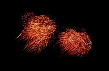 Red Fireworks explosion on black sky