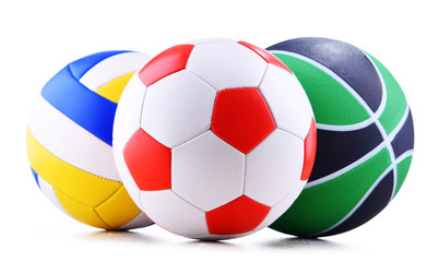 Three sport balls over white background