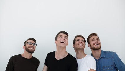 portrait of many men smiling and looking upwards