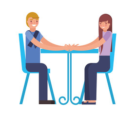 young couple sitting on chair with table