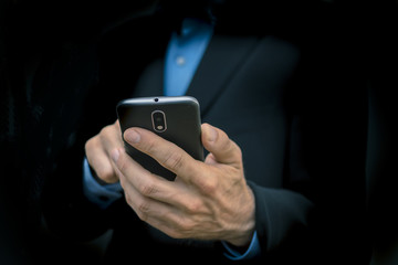 business men holding mobile smartphone in hand