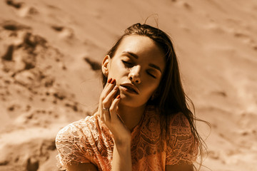 beautiful young girl with closed eyes in desert
