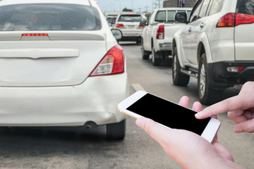 woman hand using mobile smart phone after car crash accident damage at bumper for insurance