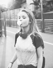 Carefree young woman chewing a bubble gum