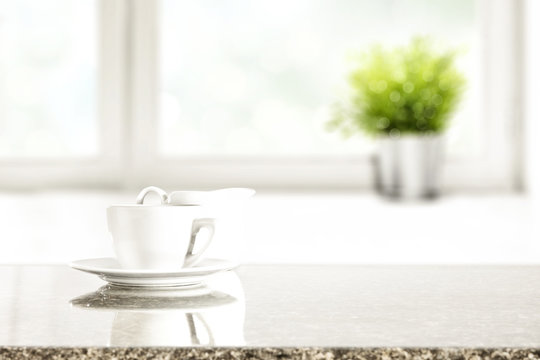 desk of free space and window background with small plant