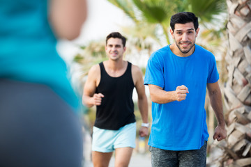 Smiling sportsmen are joggning race in time warm-up