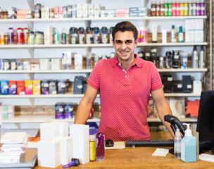 Portrait of  man seller standing in the modern sex shop