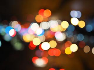 Night city street lights bokeh background, darkness concept