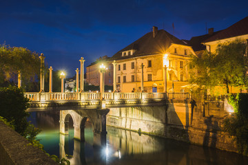Cobblers bridge over the Lublanica at night in Ljubljana, Slovenia