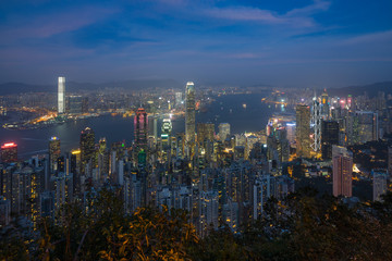 Hong Kong and Victoria Harbour at night viewed from Lugard Road, one of the best spot near Victoria Peak to enjoy the view of the city