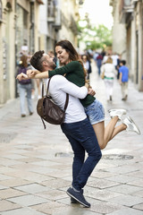 Affectionate happy tourist couple having fun in the city