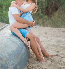 Beautiful young couple spend a day off on the beach